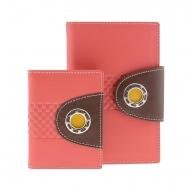 Portafoglio e portacarte in pelle liscia con decorazioni metalliche